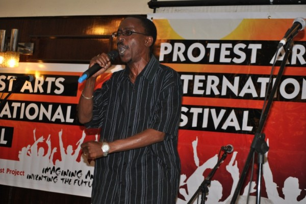 Prominent poet Chirikure Chirikure performing bomba/ bomb on the opening night of the Festival
