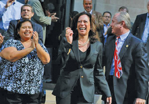 Kamala Harris (right) arrives at a campaign rally at the Los Angeles public library on Monday.
