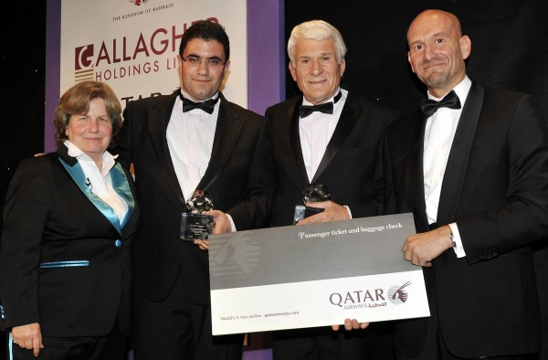 Saeed Kamali Dehghan (second left) and Antony Thomas (second right) of Mentorn and HBO, winners of the TV Feature/Documentary award, accept their award on stage presented by Paul Johannes of Qatar Airways (right) during the Foreign Press Association in London Media Awards 2010 held at the Shearton Park Lane Hotel on Piccadilly, London.