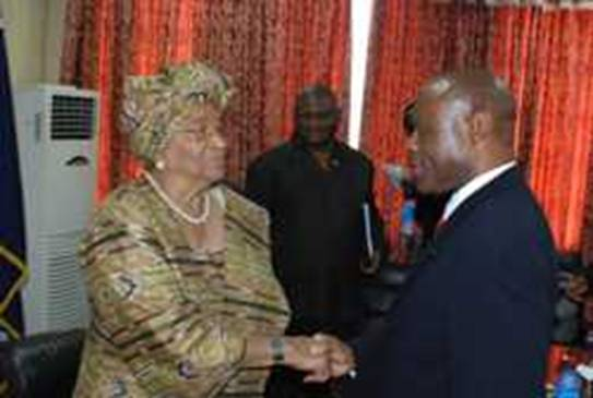 President Sirleaf meets T.Q. Harris at her Foreign Ministry office