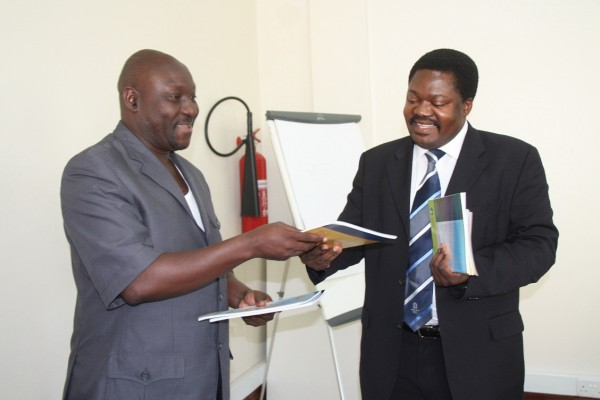The MCT executive secretary Kajubi Mukajanga with Dr Emmanuel Nchimbi, Minister for Information