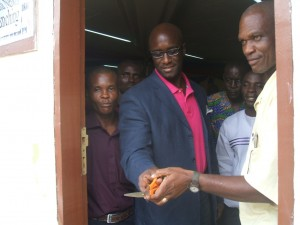 Cutting of ribbon by the Key-note Speaker & Chief Launcher to mark the official launch of the WASH R&E Network of Liberia