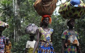 Refugees from Ivory Coast walk with their belongings through Grand Gedeh county in eastern Liberia