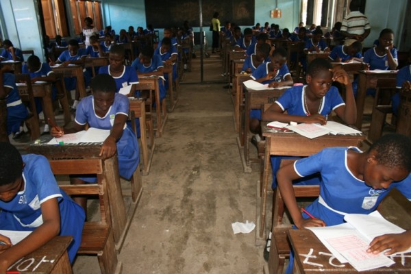 BECE student writing in Ghana in Central Region
