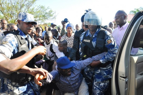 Besigye is dragged onto the police car