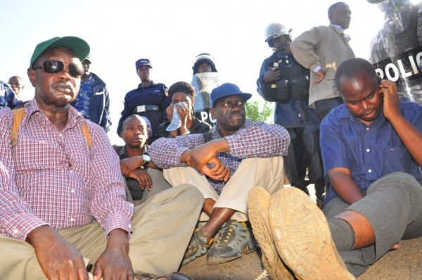Kizza Besigye with other FDC people sealed off by police in Luteete yesterday