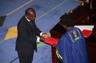 Ndugai receiving working tools from The Speaker after his election