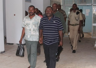 Maranda (right) and Farjala being escorted to Prison after the sentence.