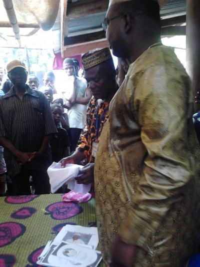 Chiefs and Elders of Bong County present kola nuts to Hon. J. Mike Kollie, as a sign of love and appreciation