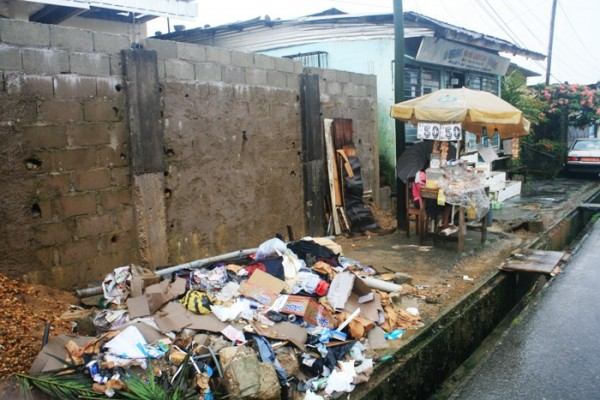 Garbage beside residential housing structures are common