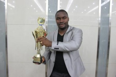 President Kuoh holds Trophy won by his club
