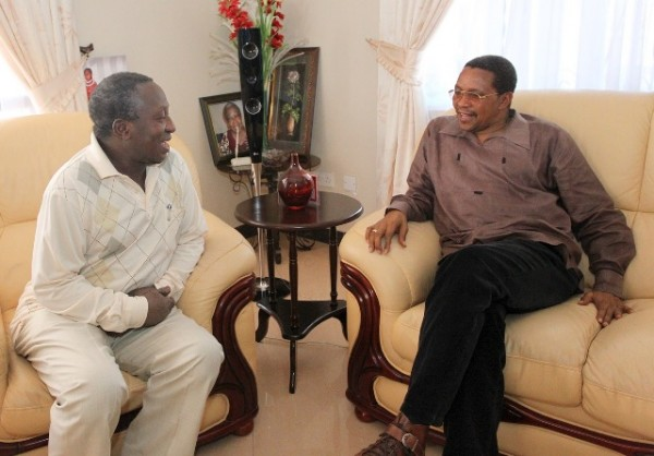 Tanzanian President Jakaya Kikwete (right) talks to Deputy Minister Dr. Harrison Mwakyembe after visiting the Minister at his residence in Mbezi, Dar es Salaam over the weekend. Dr. Mwakyembe was flown to India for treatment of a possible poison attack.