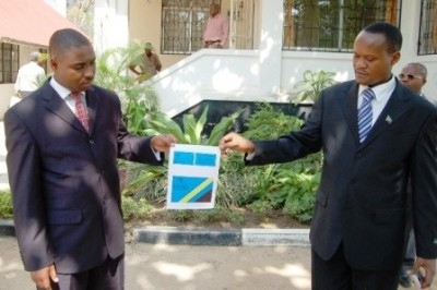 CCK's chairman Constantine Akitanda and the party secretary general Renatus Muhabi displays a sample of their party's flag to journalists and other onlookers.