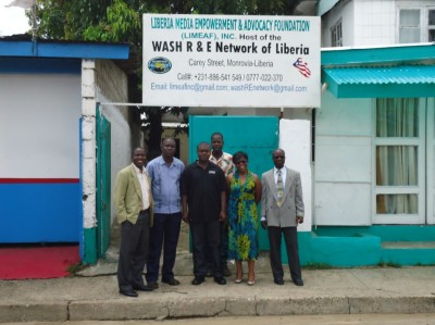 Group photo in front of WASH R&E Office in Monrovia