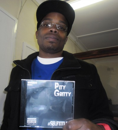 Pitygritty holding his selftitled debut album