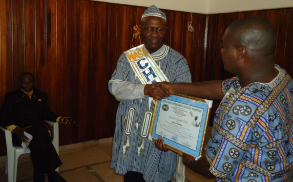 WASH R&E Chairman, Augustine N. Myers presents Certificate of Honor to WASH Champion, Mr. Samuel H. Pieh, as Rep. Richmond Anderson of Montserrado County looks on