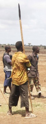 Youth stand on guard with spears yesterday in Kenya's Tana Delta District where tribal clashes have claimed 41 lives