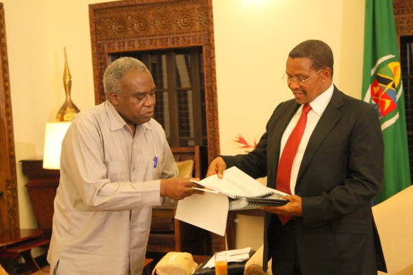 President Jakaya Kikwete of Tanzania receives various documents from the chairman of the APRM Tanzania Governing Council, Prof. Hasa Mlawa being preparations for the president to submit his country's report in Addis Ababa, Ethiopia on 26 January, 2013. (Photo courtesy of Freddy Mary of State House)