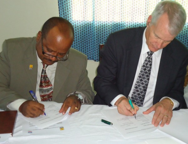Signing of the Grant Agreement between Living Water International-Liberia Country Director, Ambaye Zekewos(Left), and Chevron Liberia Limited Country Manager, Karl Cottrell(right)