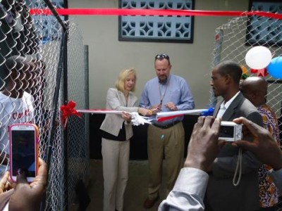 Cutting of ribbon to the modern latrine by USAID Acting Mission Director, Kimberly Rosen(L), and Chevron Liberia Supply Chain Manager, Richard Weaver (R)