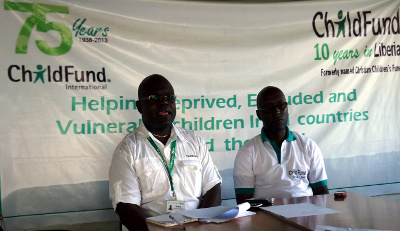 Child Fund Liberia's Acting Country Director, Godfrey Mwelwa, speaking at the                   news conference along with the Entity's Acting Program Manager, Shannon Kandoh