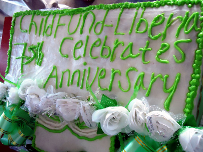 Cake with the inscription of ChildFund-Liberia's anniversary celebration