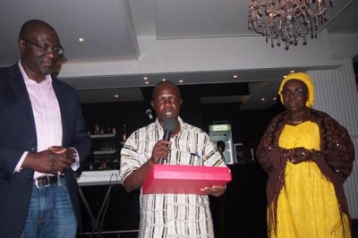 Assistant Public Works Minister for Community Services, George Yango receiving the gift from WaterAid on behalf of the Liberia government