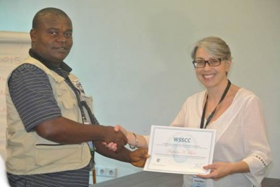 One of the Participants, Gus Myers of Liberia receives Certificate from WSSCC's Programme Manager for Advocacy and Communications, Amanda Merlin