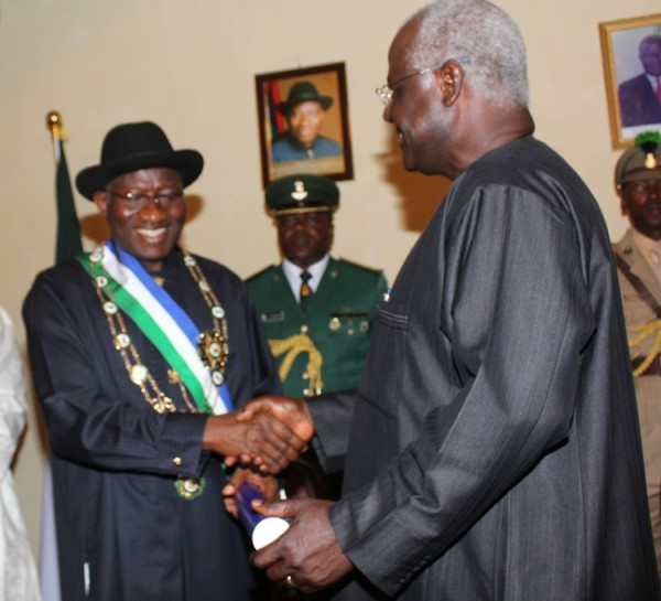 President Ernest Koroma of Sierra Leone congratulating President Goodluck Jonathan shortly after he was decorated with the Honourary Grand Commander of Sierra Leone at the State House, Freetown. Photo by Abayomi Adeshida 29/10/2012