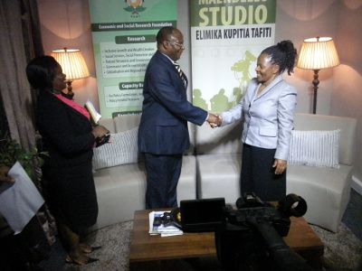 Shaking hands Dr Lunogelo and Ms Mwasha