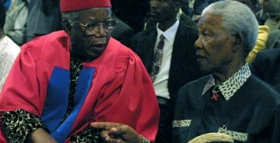 The late Professor Chinua Achebe chats with the late President Nelson Mandela while he receives an honorary doctorate degree from the University of Cape Town