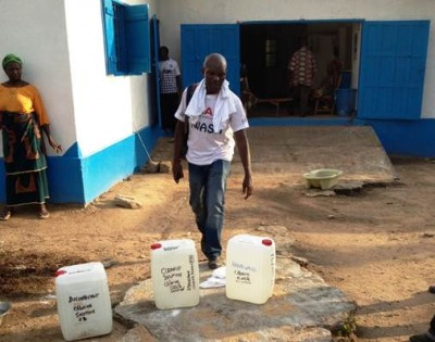 Delivering Disinfectant and hand-washing chlorine solutions to clinic in Foya