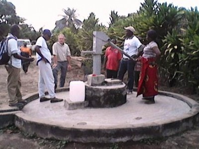 IWASH, MOH and MPW Team discussing the rehabilitation of the Sulormba Clinic hand pump in Foya, Lofa county
