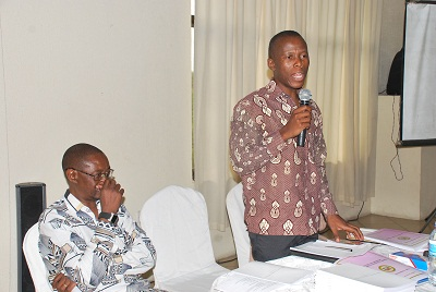 Mr Humphrey Polepole former commissioner of the CRC presenting a paper on the constitutional process, on his left is Mr Richard Shaba-Team Leader KAS