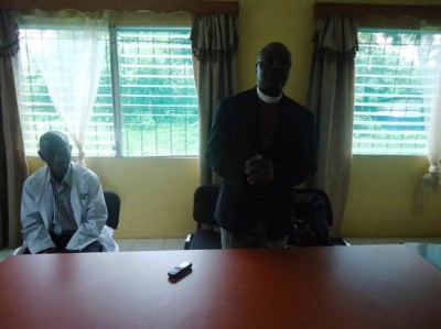 Lutheran Bishop, Dr. D. Jessen Seyenkulo interacting with Healthcare Workers, as Curran Lutheran Hospital Medical Director, Dr. Willie L.B. Roberts listened