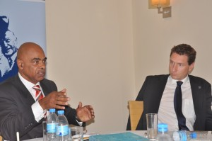 Discussing a point is Ho, Charles Huber (L) he is flanked by his host Mr Stefan Reith the Resident Director of the Konrad-Adenauer-Stiftung (KAS).
