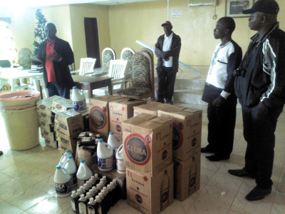 Margibi Health Team gladly receiving the items from Living Water International