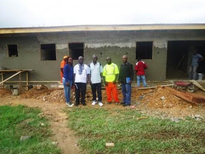 Team from Act Alliance Liberian Forum with Phebe authority and contractor