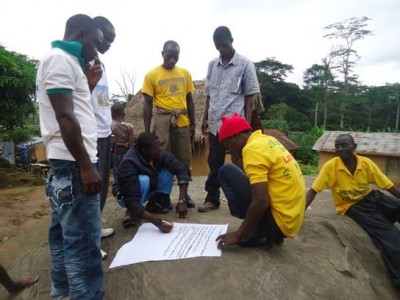 Zuvasu Town, Kolahun District , Lofa County Residents in a break up session on Ebola Prevention