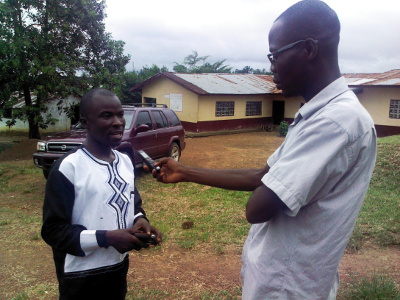 Living Water International Acting Country Director, Pastor Austin Nyaplue                                  in a chat with the WASH Media Network, at the close of the distribution