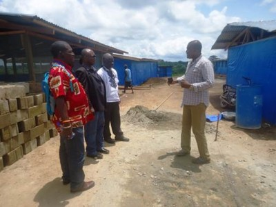 Care-Taker Head of newly built Ebola Treatment Unit in Bong County, briefing Act-Alliance Team during the assessment visit