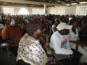 "Residents of Virginia listening to WASH Sector Partners during the launch of Operation ""WASH Ebola Away"""