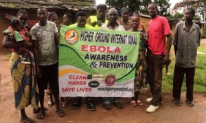 Arthington Mayor (middle) along with Zagamah Town Chief (Lady closed to him), displaying HGI's Ebola Awareness Banner with smiles at the start of the distribution