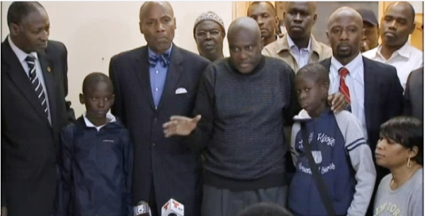 New York State Senator Bill Perkins joined community leaders and parent of two Senegalese boys beaten, called Ebola.  Ahmadou Drame, jr. 11 - second from left, Senator Bill Perkins - third from left,  Ahmadou Drame - boys father - center, Pape Drame, 13 -fifth from left, Charles Cooper, Jr. chair of African Advisory Council - sixth from left.