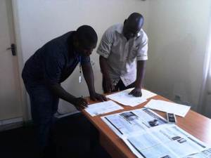 Reviewing documents of the vehicle (L-R), WASH R&E Chairman, Augustine N. Myers and Oxfam Liberia Country Director, Salifu MM Sledge