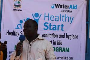 """WaterAid's Team Leader for Liberia and Sierra Leone, Chuchu K. Selma, giving an overview of """"Healthy Start"""""""