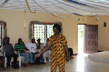 Elizabeth Geddeh motivates a group of new NL at a training in Gbarnga