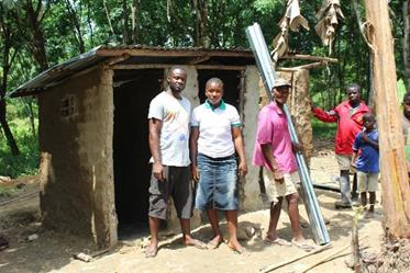 NL and the town chief of Baysah Farm, another ebola-affected village, with a new set of latrines