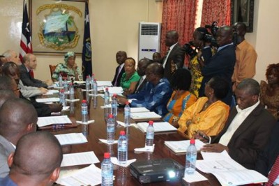 President Sirleaf with Members of the National Water Resource Sanitation Board and WASH Partners