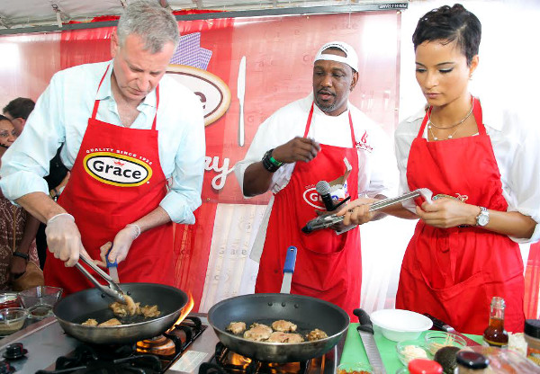 From left to right, New York City's Mayor Bill de Blasio, Chef Irie and Miss Universe Jamaica Kaci Fennell at the Grace Jamaican Jerk Festival NY at Roy Wilkins Park in Queens.